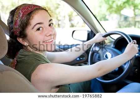 stock photo : Beautiful, confident teen girl behind the wheel of her car.