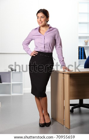 Beautiful confident young business woman in office