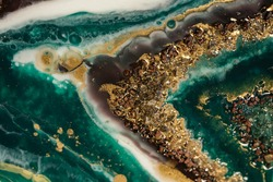 beautiful contemporary art in resin art technique. rich green and turquoise lines merge and turn into white and gold streams and blotches of gold stones, creating an imitation of bubbles in sea water