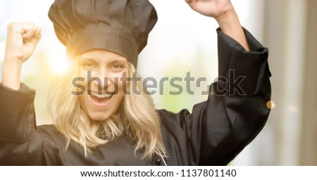 Beautiful cook woman chef happy and excited celebrating victory expressing big success, power, energy and positive emotions. Celebrates new job joyful #1137801140