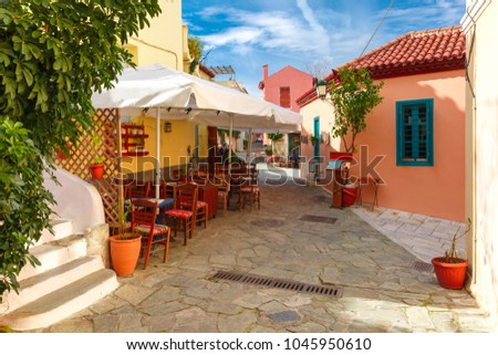 Beautiful cosy narrow street with stairs in famous Placa district, Old Town of Athens, Greece #1045950610