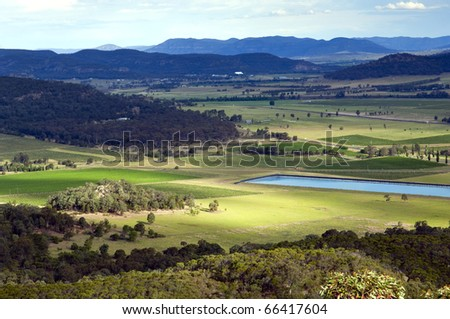 Beautiful country area with small town and brightly colored fields