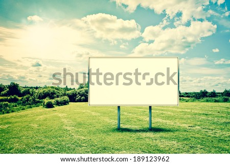 Beautiful countryside landscape with a billboard sign