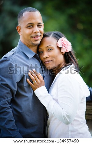 Beautiful couple embracing - stock photo