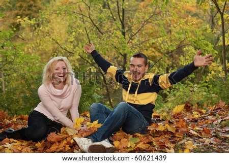beautiful couple having fun in autumn park