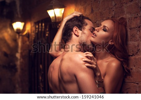 Beautiful couple having sex in gorgeous place. Man kissing woman�¢??s neck