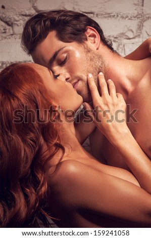 Beautiful couple having sex. Kissing each other being nude