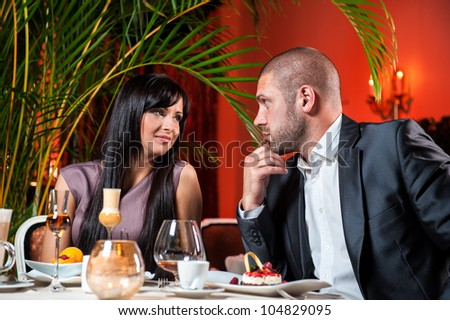 Beautiful couple in love at restaurant