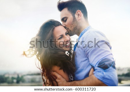 Beautiful couple in love dating outdoors and smiling #600311720