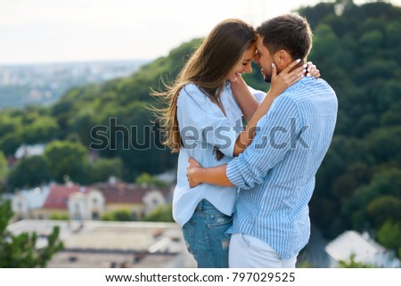 Beautiful Couple In Love Embracing Each Other In Nature. Portrait Of Happy Woman And Handsome Young Man In Stylish Clothes Hugging And Enjoying Date Outdoors. Romantic Relationship. High Resolution. #797029525