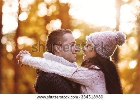 Beautiful couple in love on a walk in autumn forest #334518980