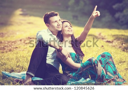 beautiful couple in park - stock photo