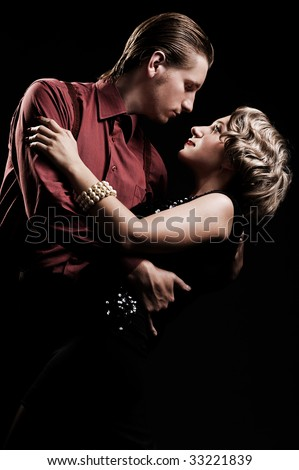 beautiful couple in retro style is dancing