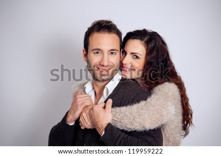 Beautiful couple in studio on gray background
