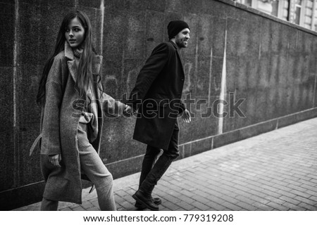 Beautiful couple in stylish clothes in gray tones, city