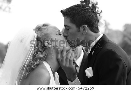 beautiful couple kissing at wedding ceremony