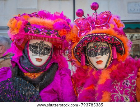 Beautiful couple of masks at Venice Carnival.