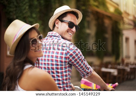 Beautiful couple on bicycle in the city