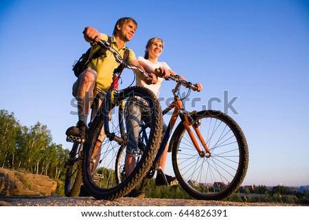 beautiful couple on bicycles on ...