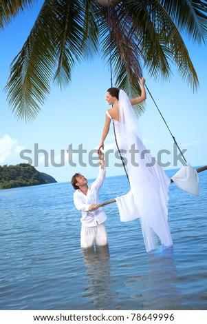 beautiful couple on the beach in wedding dress