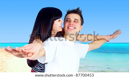 Beautiful couple on the sunny tropical beach