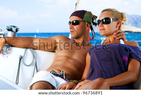 Beautiful Couple resting on the Yacht