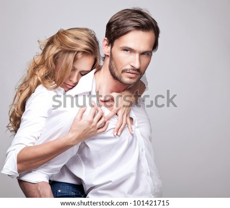 Beautiful couple touching each other - stock photo