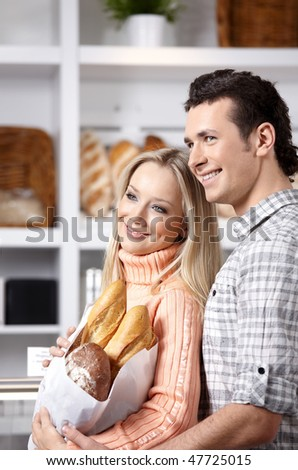 Beautiful couple with grain products on a forward background