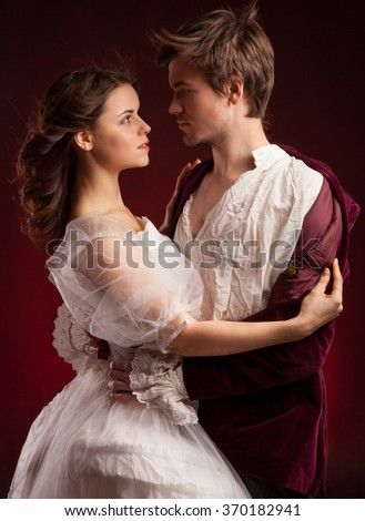 Beautiful couple woman and man in medieval clothes