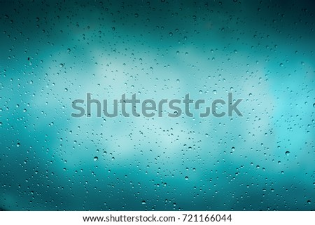 Beautiful cover of gradient background. Rain drops on glass with dark clouds. Greeting for design #721166044