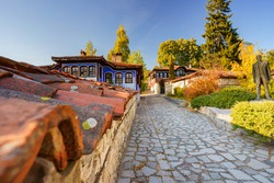 Beautiful cozy old cobblestone street with vintage blue house in the historic town Koprivshtitsa Bulgaria