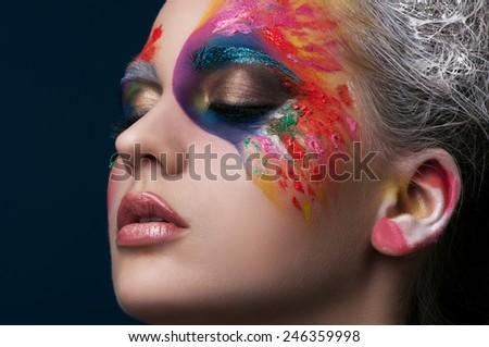 Beautiful creative makeup on fashion girl