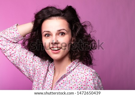 beautiful curly girl in pajamas, pink background #1472650439