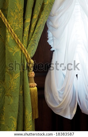 Beautiful curtains with an ornament in a luxury apartment