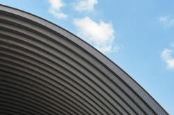 Beautiful curved roof against the sky background
