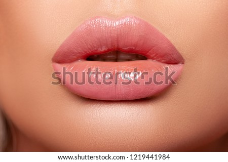 Beautiful curvy feminine lips with nude lipstick. Large Volumetric Lips, mouth open, puffy lips, glossy lipstick glaze. close-up. - Image