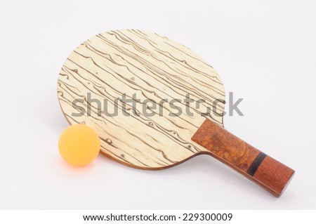 Beautiful custom table tennis racket with ball on white background