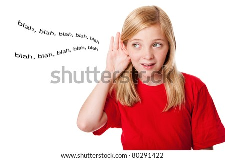 Beautiful cute blond teenage girl with hand directing ear listening hearing words. Concept what kids hear. Isolated.
