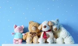 Beautiful cute family toys on the table in light blue starry room