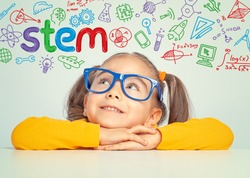 Beautiful cute little girl with eyeglasses looking at colorful STEM word and symbols above her head.  E-learning, modern and innovative Stem education concept.