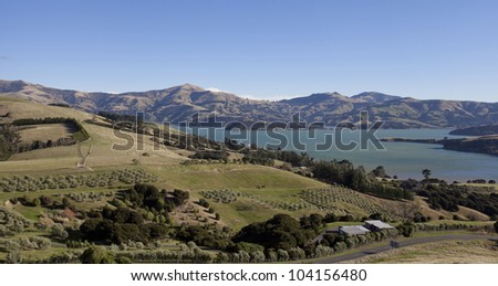 Beautiful dairy farmland scenery on the top mountain Akaroa town Southern island New Zealand