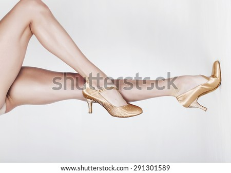 Beautiful dancer legs wearing ballet shoes horizontal