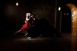 Beautiful dancers performing an argentinian tango.