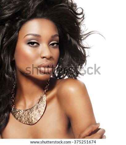 Stock Photo Beautiful dark model wth big hair and bronze statement choker. Fashion and beauty with African dark skin model.