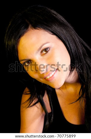 Beautiful dark woman portrait - isolated over a black background