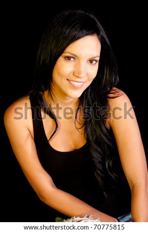 Beautiful dark woman smiling - isolated over a black background