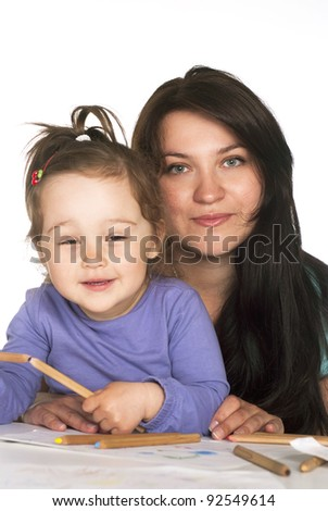 beautiful daughter draws with her mother - stock photo