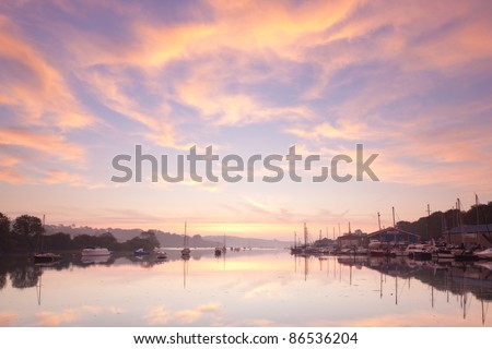 Beautiful dawn sky over the tidal River at Penryn Cornwall England UK