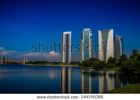 beautiful day during blue hour at Putrajaya Lakeside, Malaysia. hotel and building reflection on the lake. blue sky #544590388