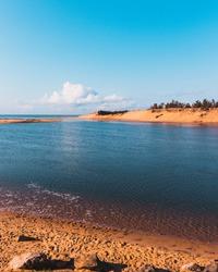 Beautiful daytime landscape of Puri with rocks and dark blu-green  water